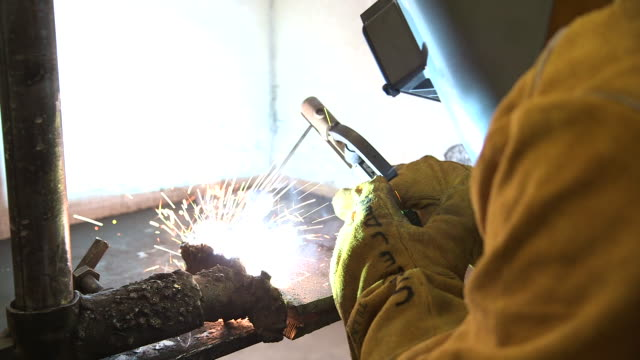 person welds pipe sparks - respiratory equipment stock videos & royalty-free footage