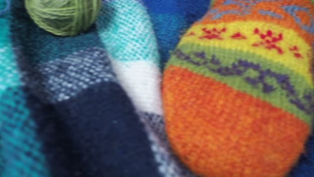 Person with colorful balls of wool