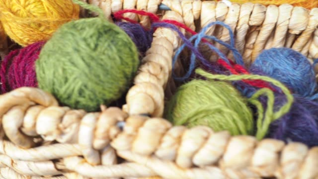 person with colorful balls of wool - ball of wool stock videos & royalty-free footage