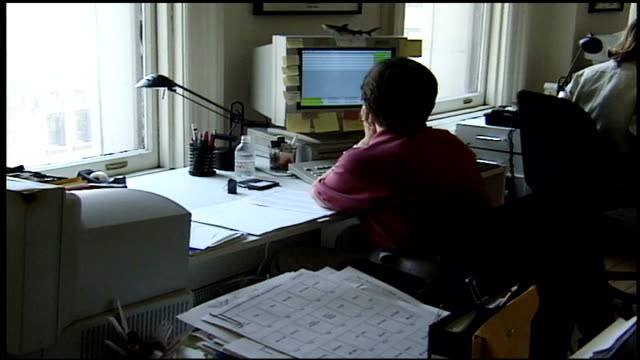 stockvideo's en b-roll-footage met person working on computer with shark on monitor - 1997