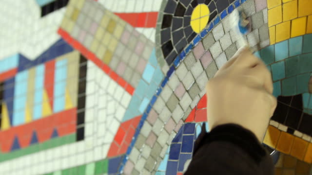 cu person working on mosaic renovation at tottenham court road underground station / london, england, united kingdom - mosaic stock videos and b-roll footage