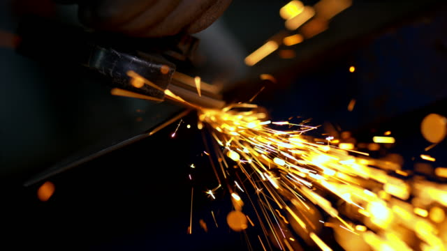 SLO MO Person working with an angle grinder