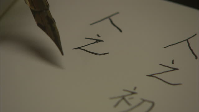 cu, person writing mandarin characters, close up of nib, singapore - chinese script stock videos & royalty-free footage