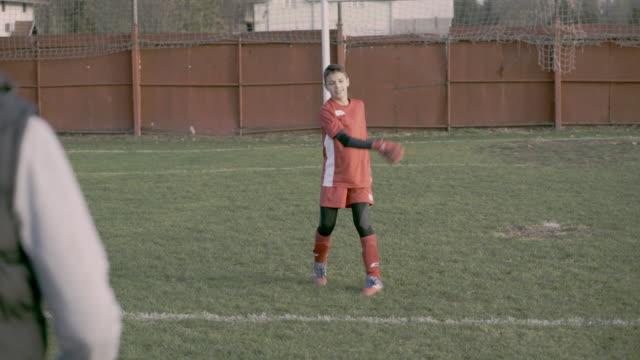 personal goalkeeper trainer - soccer goalkeeper stock videos & royalty-free footage