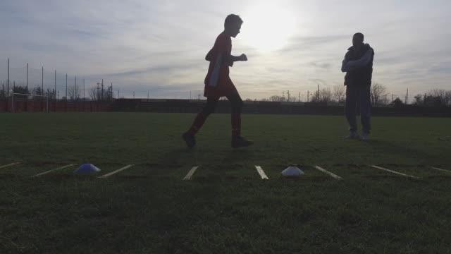 personal goalkeeper trainer - goalkeeper stock videos & royalty-free footage