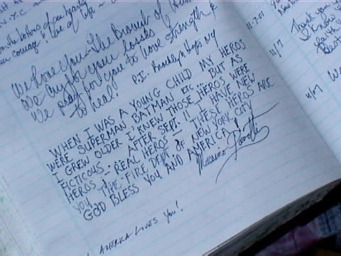 personal notes of condolences and thanks written in a book at a makeshift memorial near ground zero in the aftermath of the 9/11 terrorist attacks - resourceful stock videos & royalty-free footage