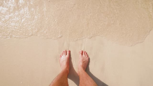 personal perspective of a man standing on a beach - human foot stock videos & royalty-free footage
