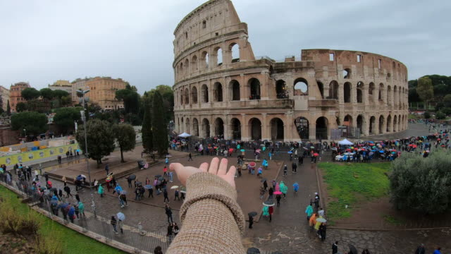personal perspective of camera in front of colosseum, italy - amphitheatre stock videos & royalty-free footage