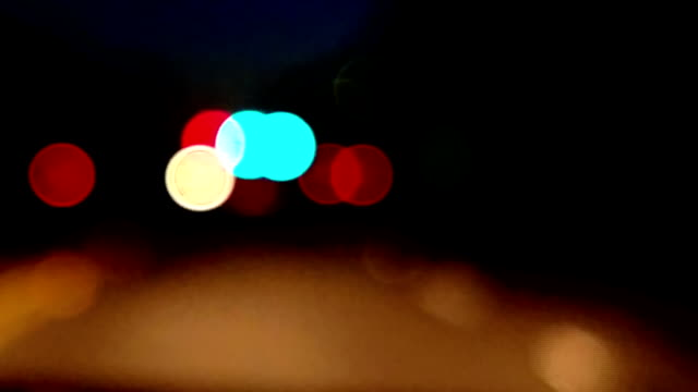 personal perspective of driving on city street at night. - loopable moving image stock videos & royalty-free footage
