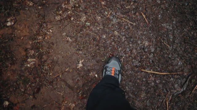 personal perspective of hikers boots on dirt road - boot stock videos & royalty-free footage