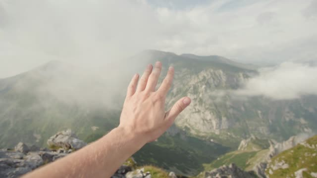 personal perspective of person on mountain top: waving hand - waving stock videos & royalty-free footage