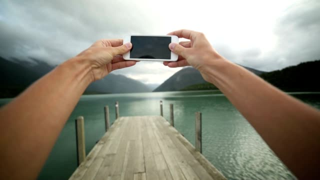 Personal perspective of person taking picture using mobile phone