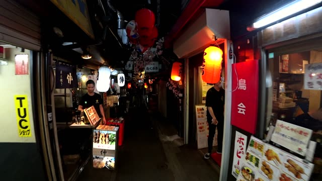 a personal perspective of traditional food street in shinjuku tokyo. - giappone video stock e b–roll