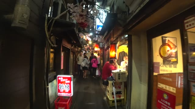 a personal perspective of traditional food street in shinjuku tokyo. - alley stock videos & royalty-free footage