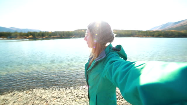 Personal perspective of woman by the lake