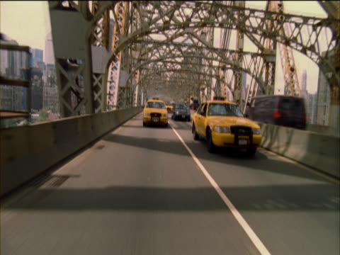 personal perspective view from the rear window of a car driving over queensborough bridge - 2005 stock videos and b-roll footage