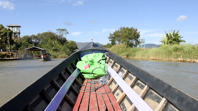 personal perspective view of a boat along a canal on inle lake. shan state, myanmar (burma). - shan state stock videos & royalty-free footage