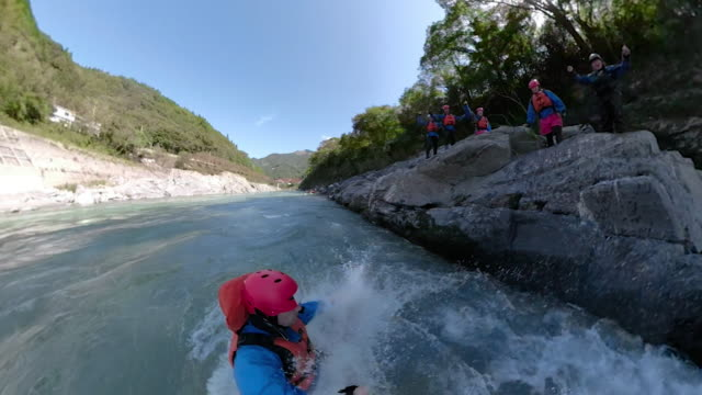 personal point of view of a man jumping into a river during a white water river rafting excursion - iya valley stock videos & royalty-free footage