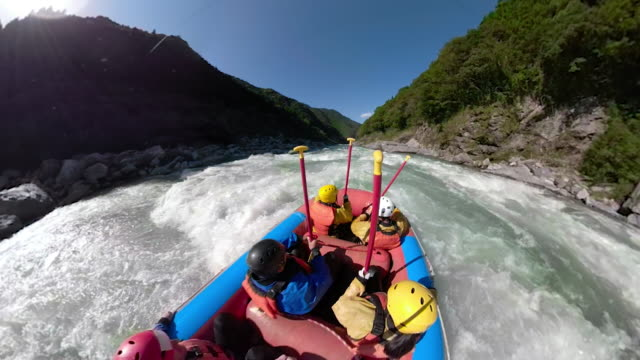 personal point of view of a white water river rafting excursion - rafting stock videos & royalty-free footage