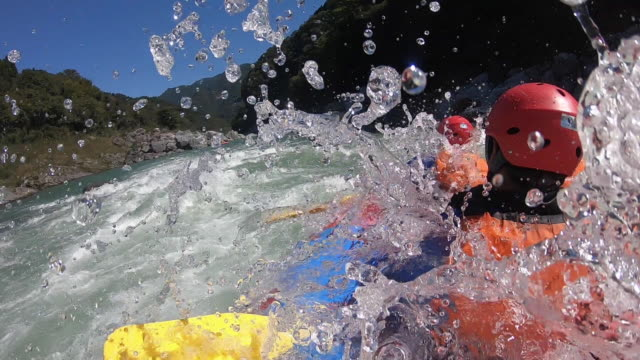 personal point of view of a white water river rafting excursion - inflatable raft stock videos and b-roll footage