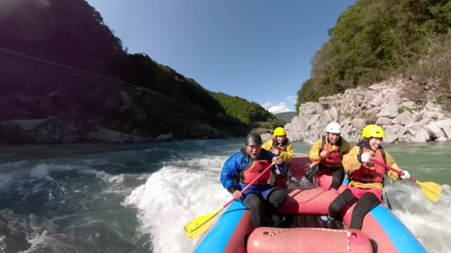 personal point of view of a white water river rafting excursion - inflatable raft stock videos & royalty-free footage