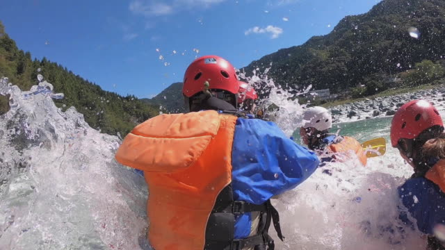 personal point of view of a white water river rafting excursion - water sport stock videos & royalty-free footage