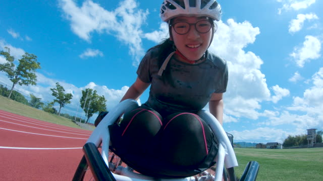 personal point of view of a young woman racing in a wheelchair - wheelchair stock videos & royalty-free footage