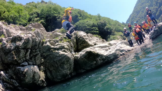 personal point of view of jumping off a cliff in slow motion - rafting stock videos & royalty-free footage