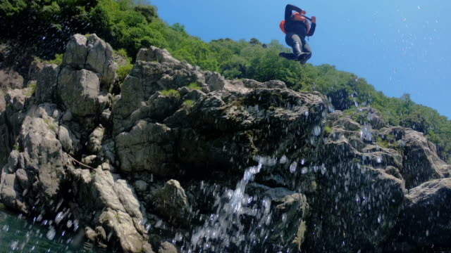 personal point of view of jumping off a cliff in slow motion - wearable camera stock videos & royalty-free footage