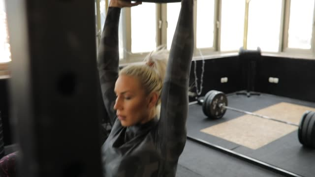 personal trainer and women on weightlifting training in gym - lunge stock videos & royalty-free footage