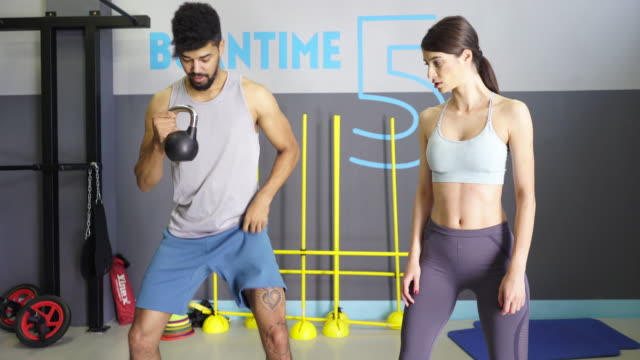 personal trainer helping - fitness instructor stock videos & royalty-free footage