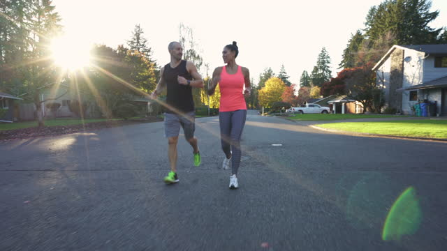 personal trainer running with client outdoors - routine stock videos & royalty-free footage