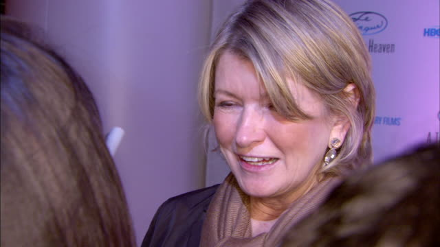 personality martha stewart on red carpet in le cirque restaurant talking to press, moving along on red carpet. - マーサ スチュワート点の映像素材/bロール