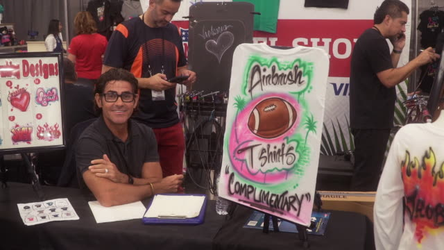 atmosphere personalized airbrush shirts at the nfl shop at super bowl presented by visa at miami beach convention center on january 28 2020 in miami... - airbrush stock videos & royalty-free footage