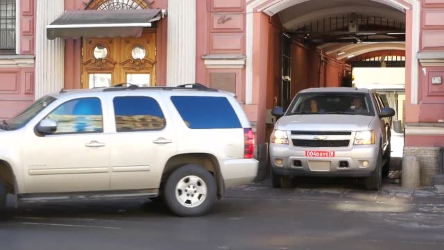 Personnel leave the US consulate in Saint Petersburg a day after Russia announced its closure along with a mass expulsion of US diplomats in...