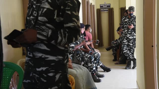 personnel waiting at a government hospital as they arrive to receive the covid-19 vaccine on march 23 in guwahati, india. starting from 1 april,... - senior men stock videos & royalty-free footage
