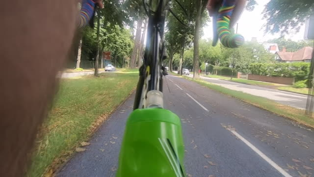 pov perspective of a person riding a bicycle on a cycle lane - west midlands stock videos & royalty-free footage