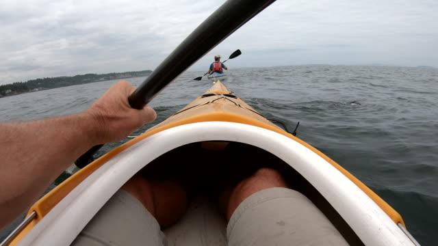 pov perspective of ocean kayaker paddling on open sea - kayaking stock videos & royalty-free footage