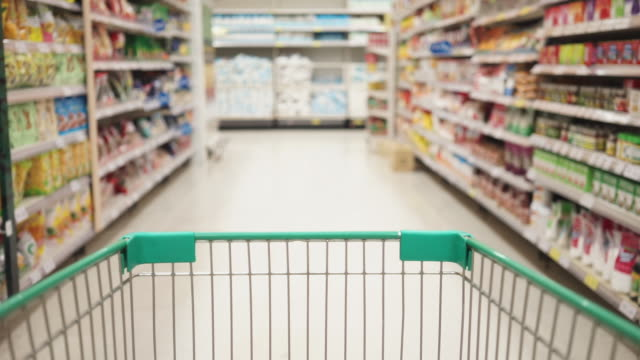 perspective of one person's shopping cart moving forward to shop in supermarkets. - animal drawn stock videos & royalty-free footage