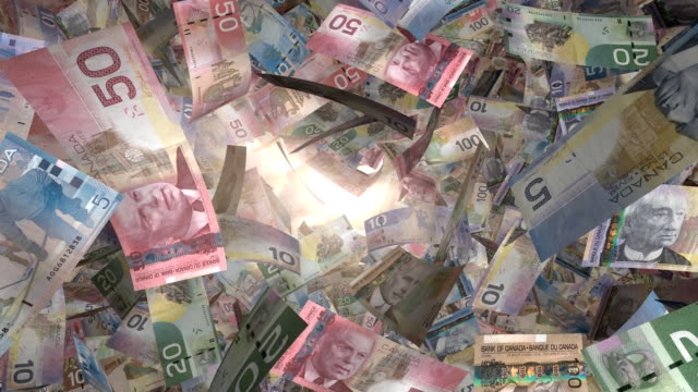 perspective view, through sunlight, of canadian money flying by (loop) - traditionally canadian stock videos & royalty-free footage