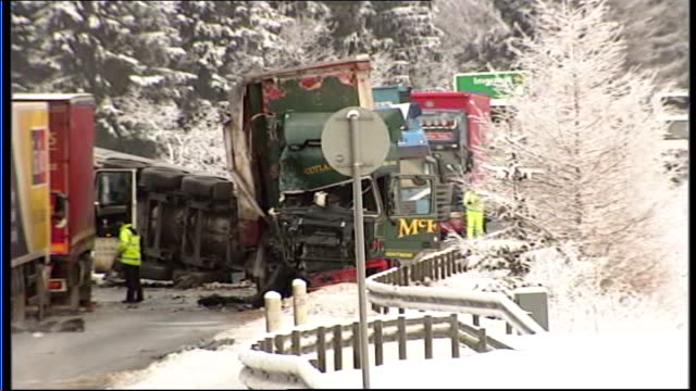 perthshire various shots of aftermath of crash involving three articulated lorries on a9 road upturned hgv truck wreckages of two others in road - perthshire stock videos & royalty-free footage