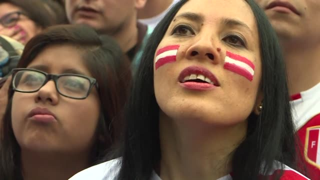 peru fans remain positive about their team's future despite a tough 10 loss to france that eliminated the team from the world cup - elimination round stock videos and b-roll footage