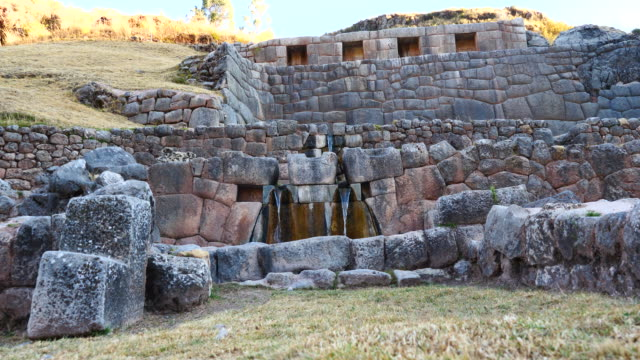 Peru, Waterfalls running through the terraced rocks in Tambomachay archeological site