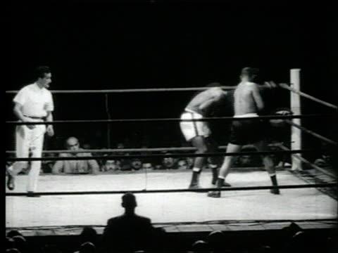 peruvian boxer mauro mina fights american jesse bowdry in boxing match mauro mina and jesse bowdry in boxing match on august 30 1961 in lima peru - peruvian ethnicity stock videos and b-roll footage