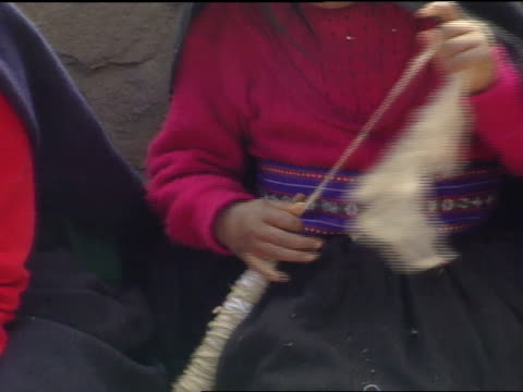 peru south america peruvian child hands stretching wool rolling onto stick material for handwoven textiles pan peruvian female hands working on... - peruvian ethnicity stock videos & royalty-free footage