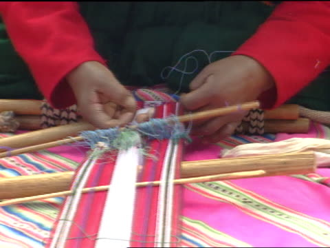 peruvian female hands working on hand-made loom, weaving thread, tightening material, patterns on hand-woven textiles. - weaving stock videos & royalty-free footage