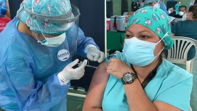 peruvian health workers receive at a hospital in lima the first dose of the vaccine from state-owned chinese company sinopharm, after the... - dose stock videos & royalty-free footage
