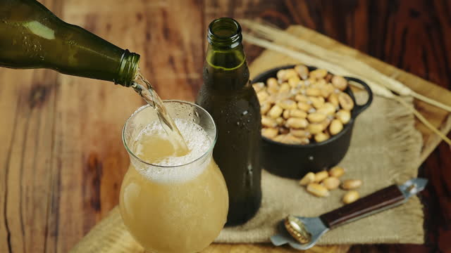 peruvian pilsner beer pouring into a glass with corn on the side - pilsner stock videos & royalty-free footage