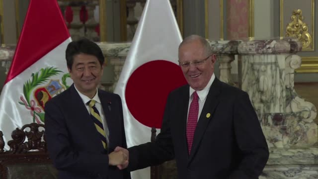 Peruvian president Pedro Pablo Kuczynski receives Japanese prime minister Shinzo Abe at the Government Palace in Lima on Friday with the two...