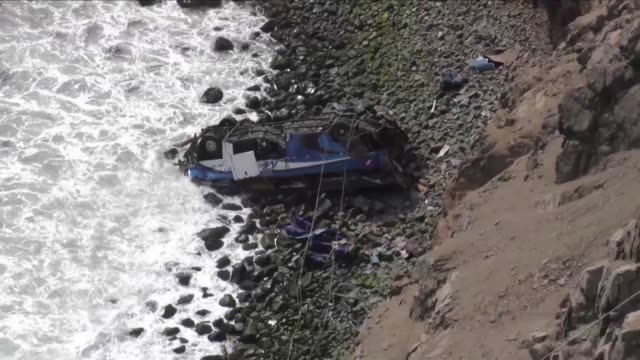 Peruvian rescue workers continue recovery efforts after a bus plunged around 100 meters over a seaside cliff north of Lima having collided with a...